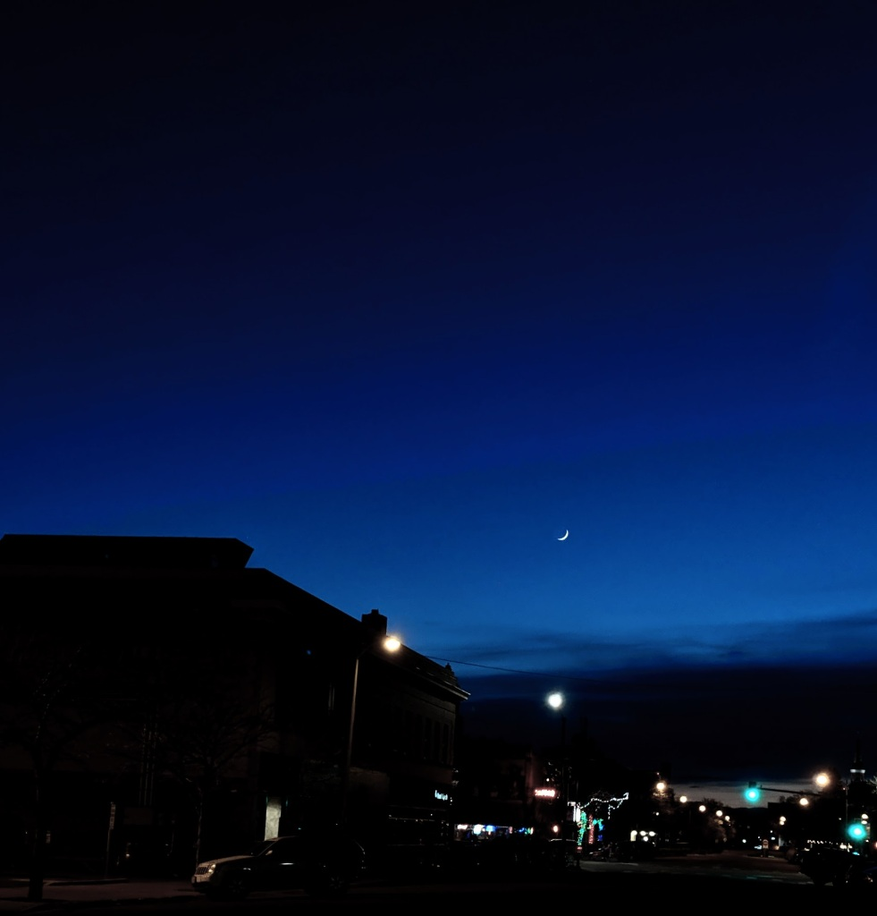 Sliver of the moon overlooking Spruce St in Missoula, MT